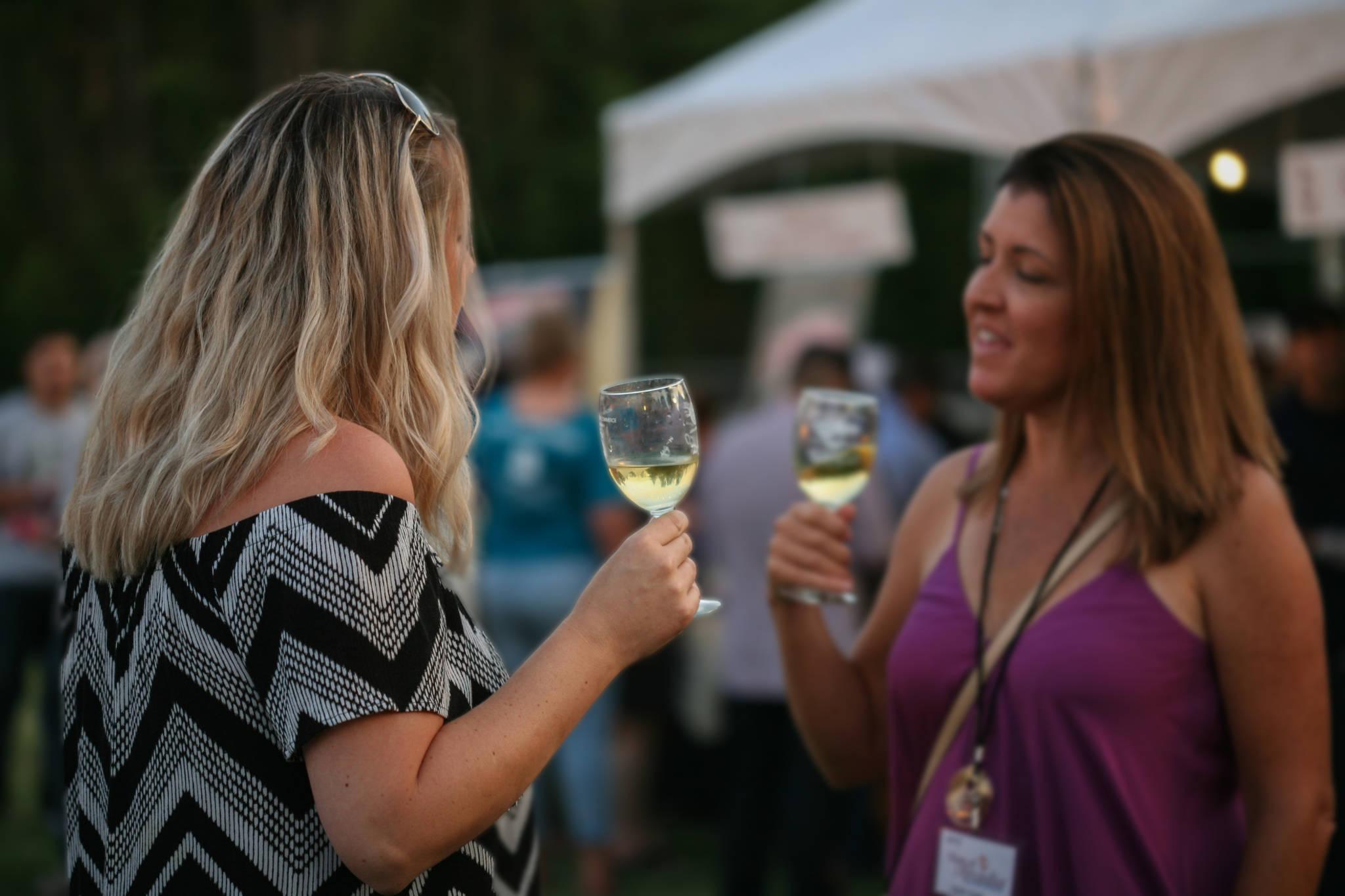 Two women enjoying a glass of wine