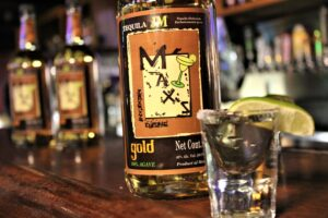 Max's Mexican Cuisine brand name tequila bottle with shot glass