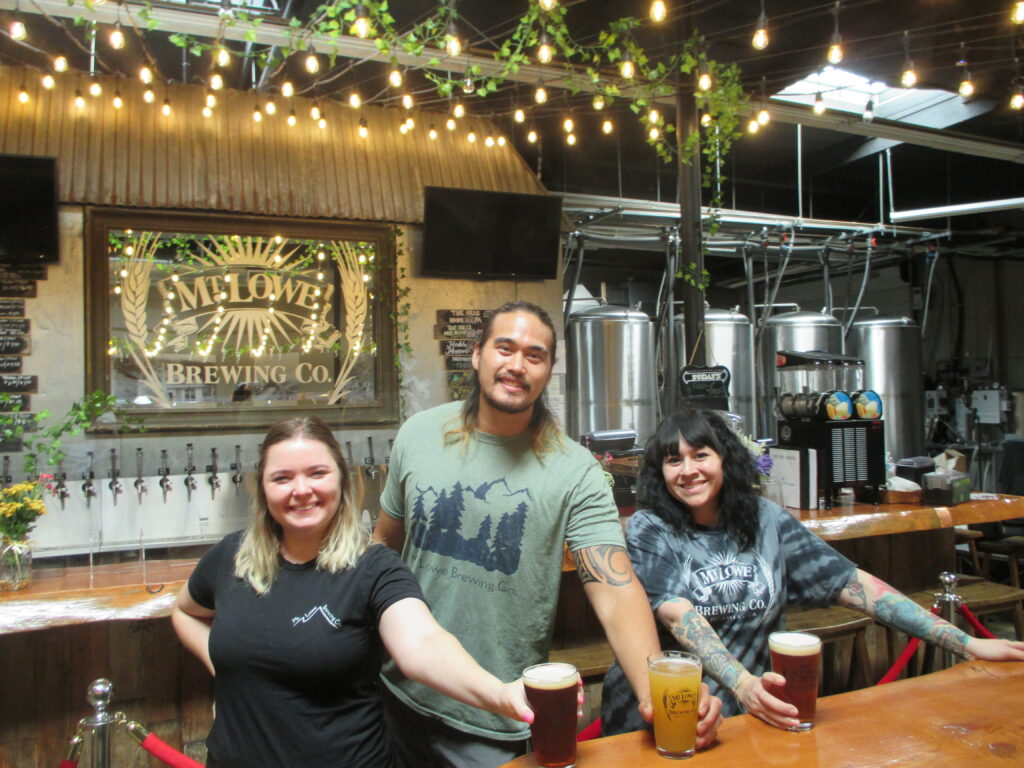 Mt. Lowe Brewing Co. Manager Christian Kama, with Sarah Wooster, left, and Lenise Albarran, serve up a sampling of the brewmasters' art at the popular tavern in North Arcadia.
