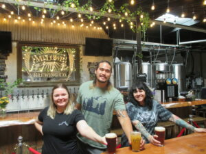 Mt. Lowe Brewing Co. Manager Christian Kama, with Sarah Wooster, left, and Lenise Albarran